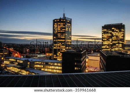 Skyscrapers in the night. Prague modern building architecture. Office and headquarters of successful bussiness companies. - stock photo