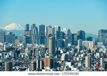 Skyscrapers in the Shinjuku Ward of Tokyo with Mt. Fuji - stock photo