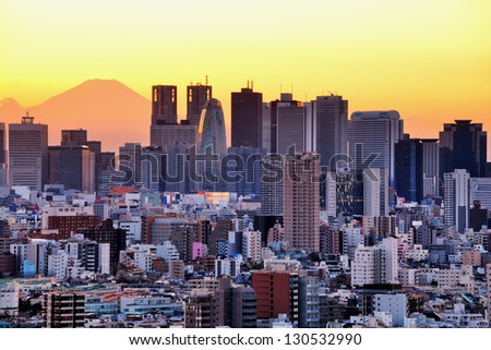 Skyscrapers in the Shinjuku Ward of Tokyo with Mt. Fuji visible. - stock photo