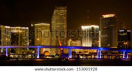 Skyscrapers lit up at night, Miami, Miami-Dade County, Florida, USA - stock photo