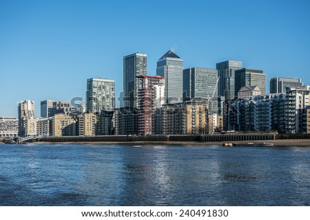 Skyscrapers of Canary Wharf seen from the river Thames in London - stock photo