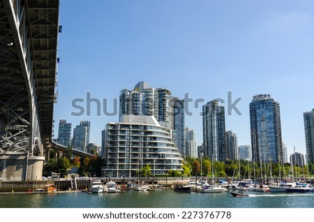 Skyscrapers of glass and mirrors viewed from Granville in Vancouver - stock photo