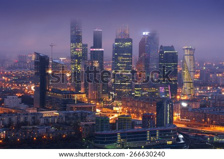 Skyscrapers of Moscow City business complex in fog at night in Moscow, Russia - stock photo