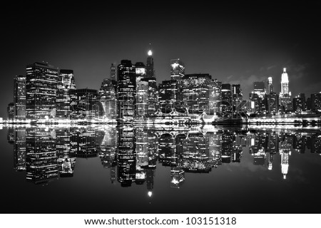 Skyscrapers of New York at night , black and white - stock photo