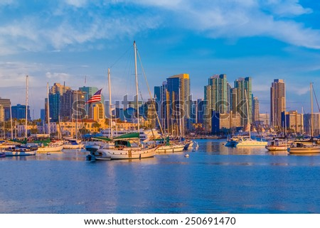 Skyscrapers of San Diego Skyline, waterfront and harbor with boats and dusk light, CA - stock photo