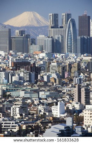 Skyscrapers of Shinjuku Ward with Mt Fuji in the background, Tokyo Prefecture, Kanto Region, Japan - stock photo