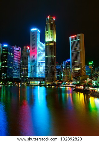 Skyscrapers of the night (Singapore City) - stock photo