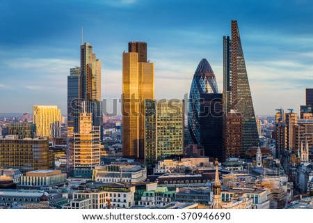 Skyscrapers of the world famous bank district of central London at sunset - England, UK - stock photo