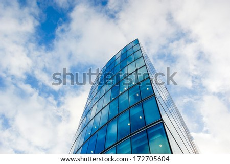 Skyscrapers office building with clouds reflection  - stock photo