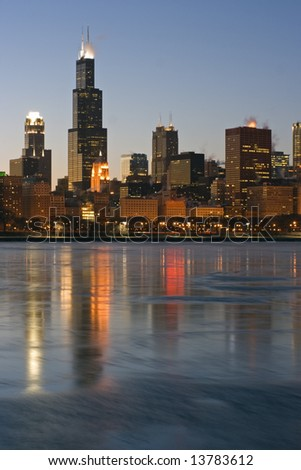 Skyscrapers reflected in icy Lake Michigan - Chicago, Il. - stock photo