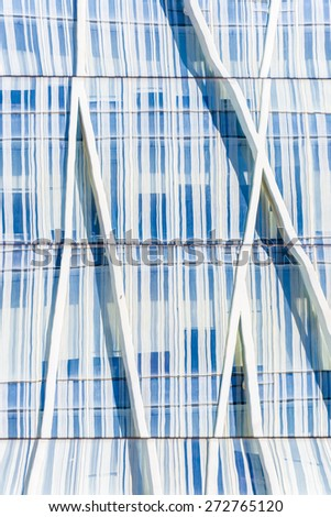 Skyscrapers reflected in the mirrors of a wall - stock photo