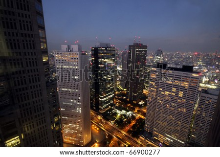 Skyscrapers starting to light up during sunset - stock photo