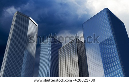 Skyscrapers under the dramatic sky. Modern glasses buildings. - stock photo