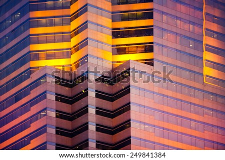 Skyscrapers walls in the evening - stock photo