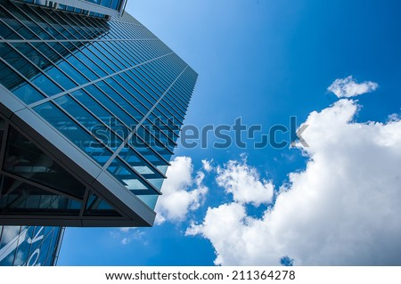 Skyscrapers with a cloudy sky - stock photo