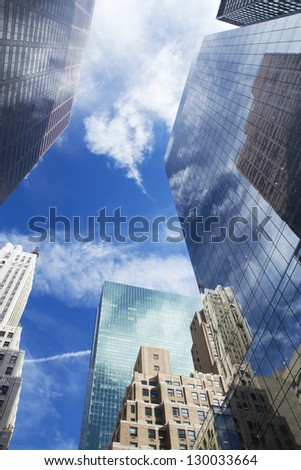 Skyscrapers with clouds reflection. Vertically. - stock photo