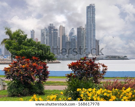 Skyscrapers with colorful tropical plants and a stormy sky, Panama City, Panama, Central America - stock photo
