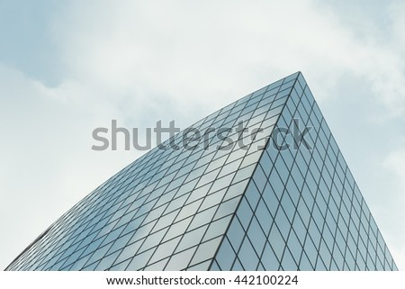 Skyscrapers with glass facade. Abstract background. Modern buildings in Paris business district. Concepts of economics, financial, future.  Copy space for text. Dynamic composition