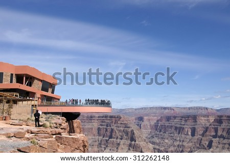 Skywalk: The floor of bridge is made of glass and suspended four thousand feet above the Colorado River on the edge of the Grand Canyon West. - stock photo