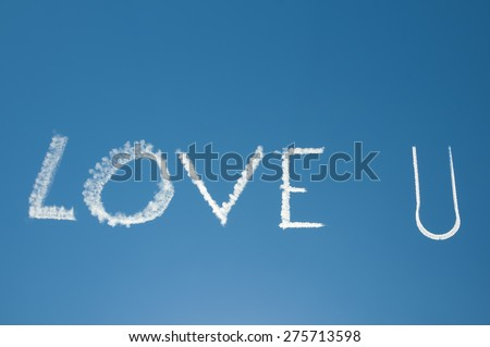 Skywriting Love you in blue sky with sun nearby - stock photo