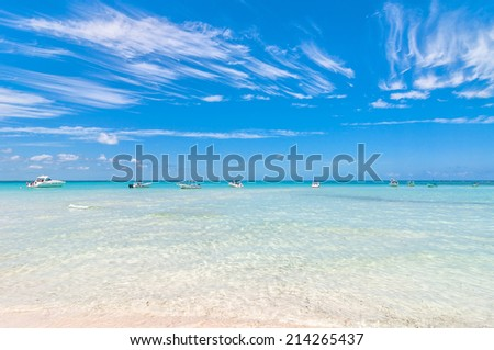 SLA MUJERES, MEXICO - APRIL 23, 2014: tropical sea and boats on famous Playa del Norte beach in Isla Mujeres, Mexico. The island is located 8 miles northeast of Cancun in the Caribbean Sea