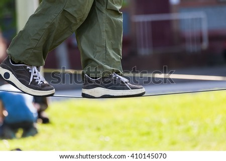 Slackline. Foots on the rope - stock photo