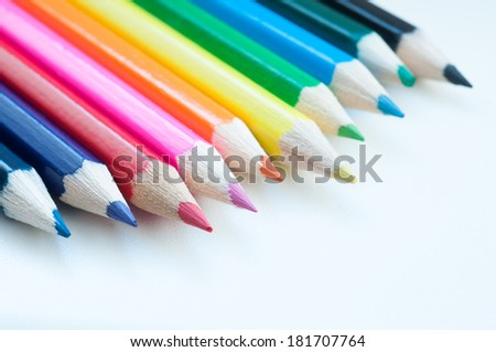 Slanting colorful wooden crayons, closeup of tips of pencils macro with shallow dof. Selective focus. - stock photo