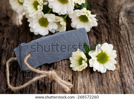 Slate and flowers - stock photo