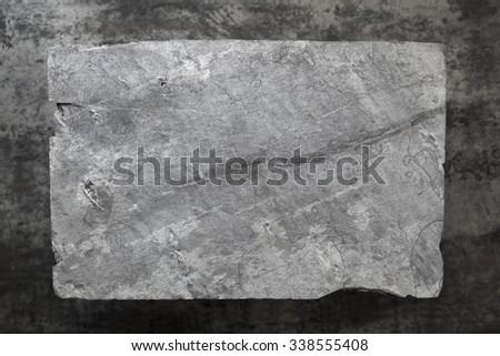Slate background.  Gray slate over dark marble. Overhead view. - stock photo