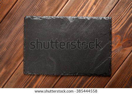 Slate board on old wood - stock photo