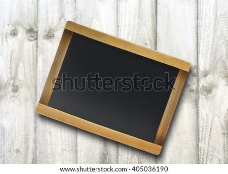 slate on wood background - stock photo
