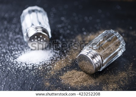 Slate slab with Salt and Pepper Shaker (selective focus; close-up shot) - stock photo