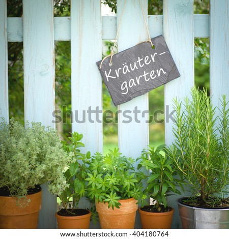 Slate with german text: Herb garden