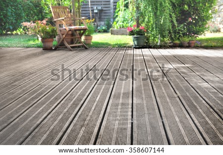 slats of a wooden terrace overlooking garden