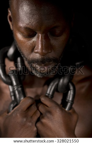 Slave In Chains - stock photo