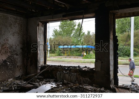 SLAVJANSK, UKRAINE - JULY 15, 2014: the result of the shelling of a peaceful town militias. Mina got into the building and there was a fire.
