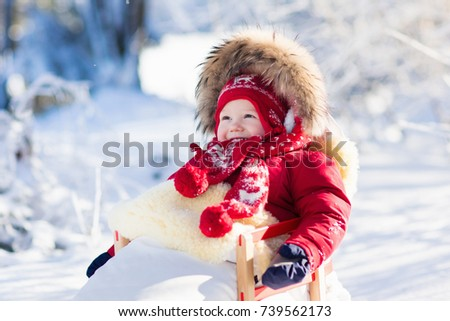 Red sled stock images royalty free images vectors for Warm winter family vacations