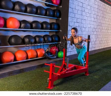 sled push woman pushing weights workout exercise - stock photo