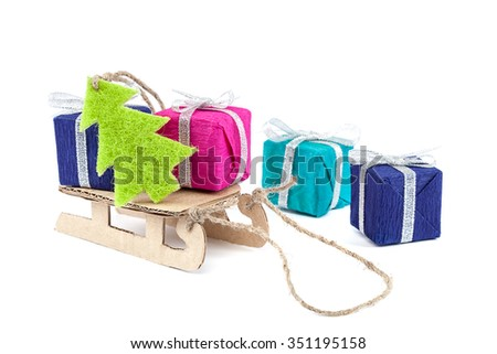 Sled with gifts and Christmas tree isolated on white background. - stock photo