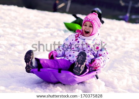 Sledding, winter fun, snow, family sledding  - stock photo