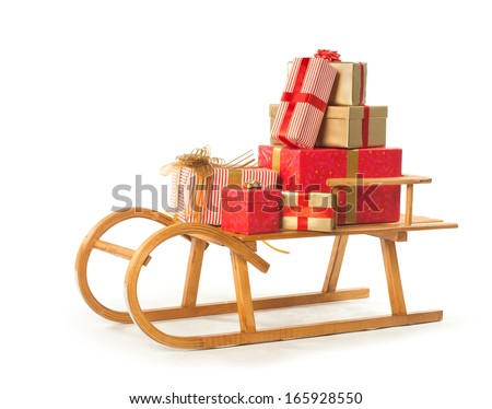 Sledge with Christmas presents on white background  - stock photo