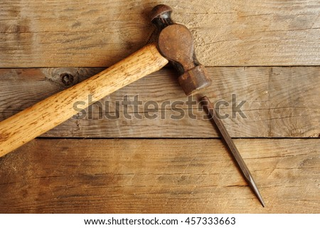 Sledgehammer and Punch on wood Background. Top View of  Sledge Hammer with Wooden Handle and punch.