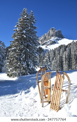 Sledges against snowy Alps - stock photo
