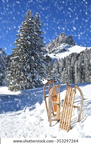 Sledges against snowy Alps - stock photo