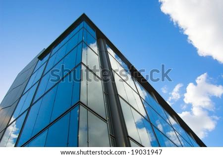 sleek office building with sky - stock photo