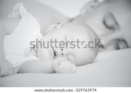 Sleep baby with dad - stock photo