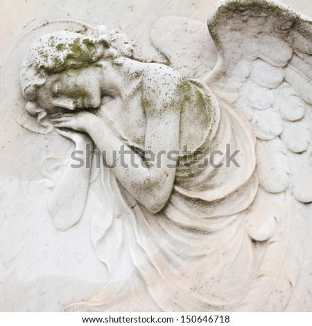sleeping angel - antique decoration on tombstone, monumental cemetery San Michele, Venice  ,Italy, Europe - stock photo