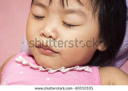 Sleeping Asian child having a sweet dream