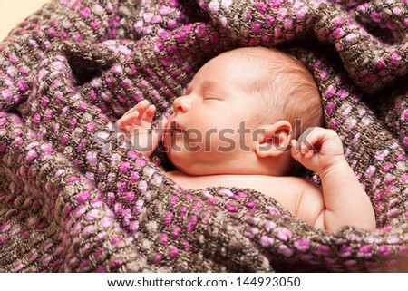 Sleeping baby at the age of three weeks - stock photo