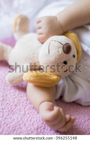 sleeping baby,baby's feet, socks, dress  - stock photo